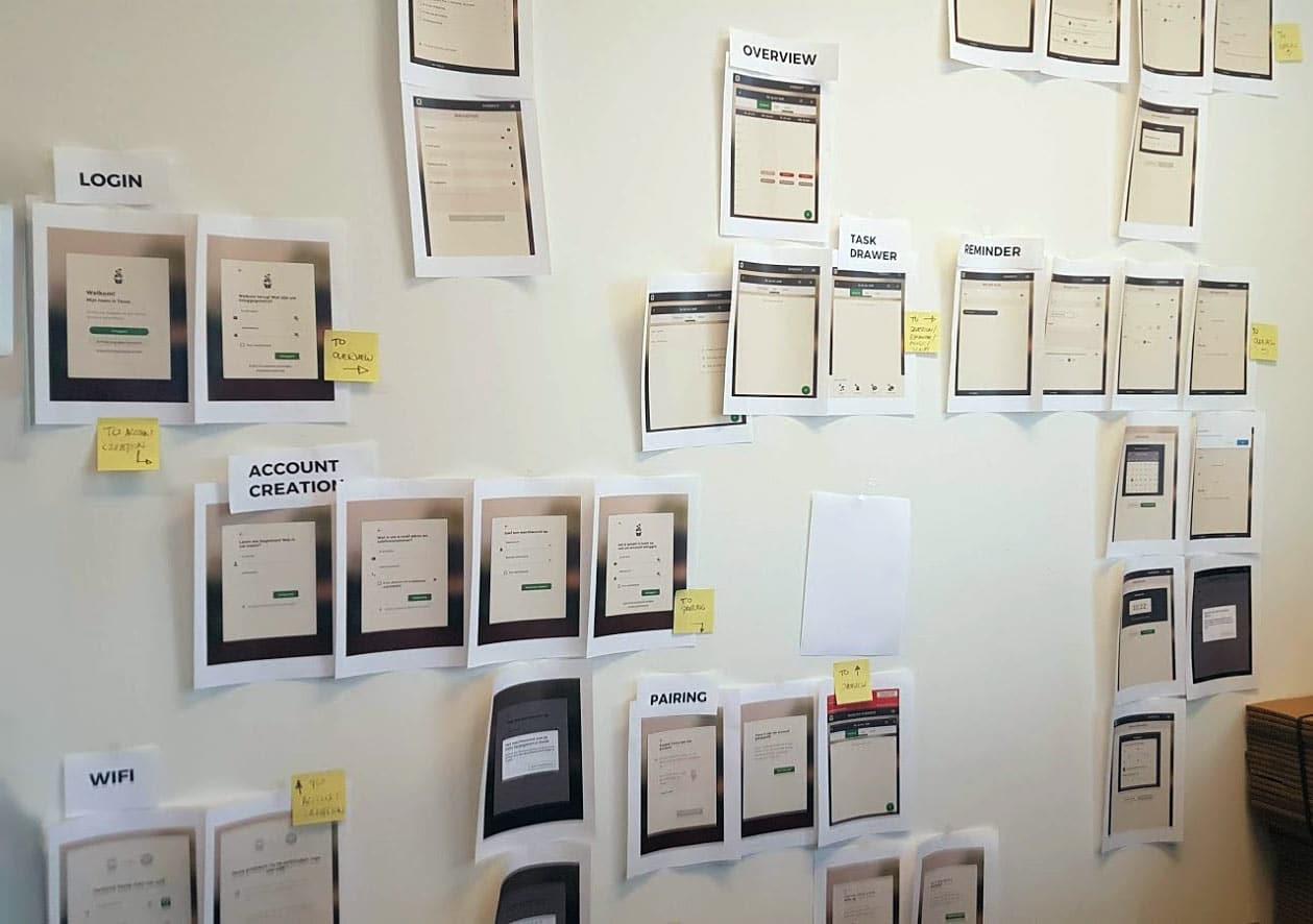 Screenshots of Tessa's app, hung on a wall