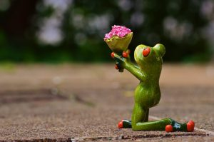 frog with low self-esteem offering flowers to princess