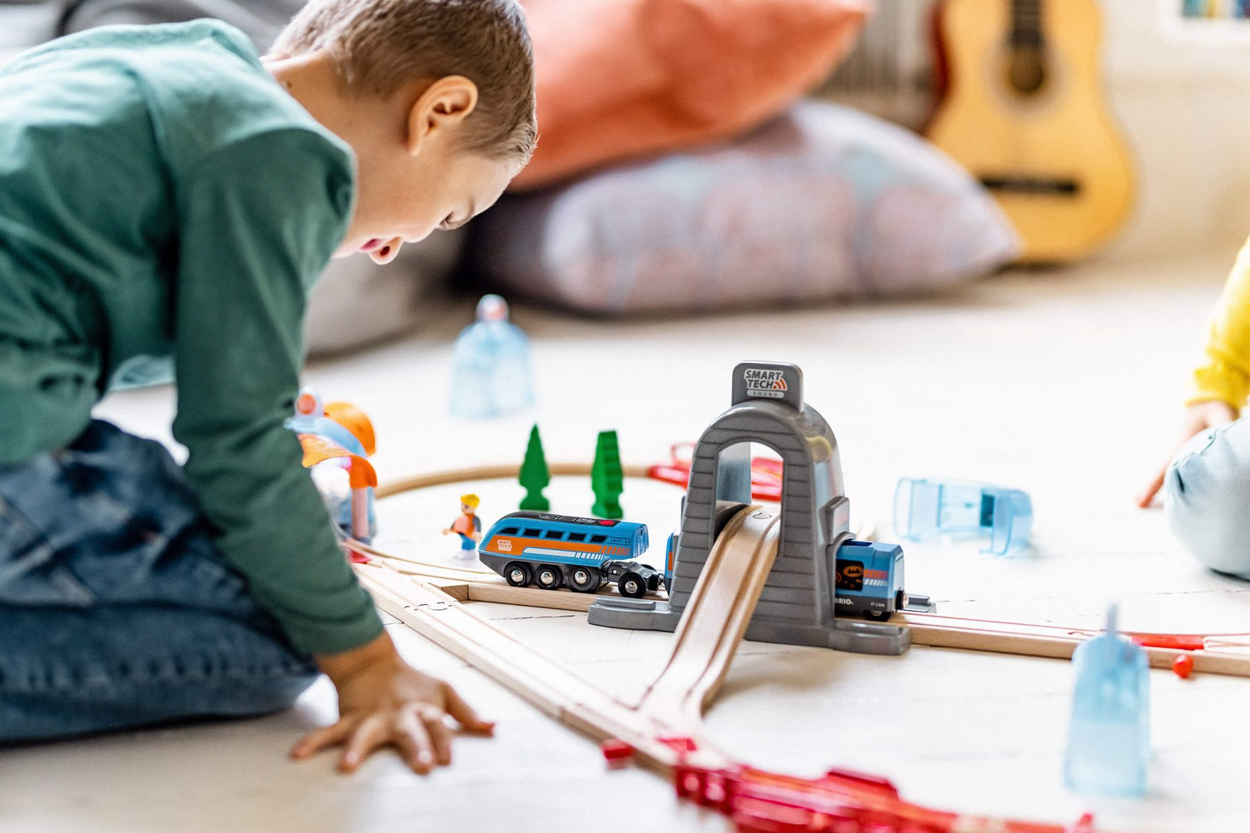 Kids playing with Brio Train on the floor