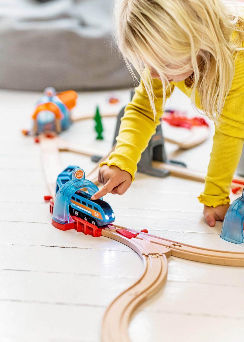 Brio, Kid playing on floor with Brio Train
