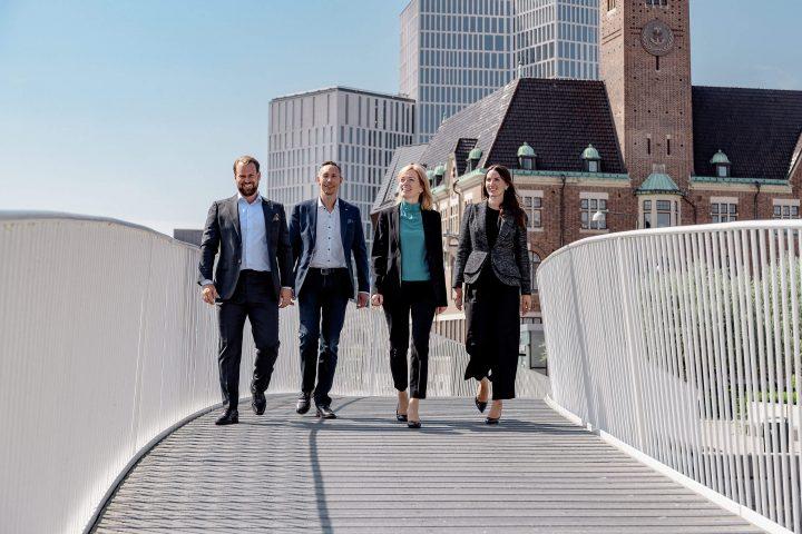 Corporate group shot on a bridge