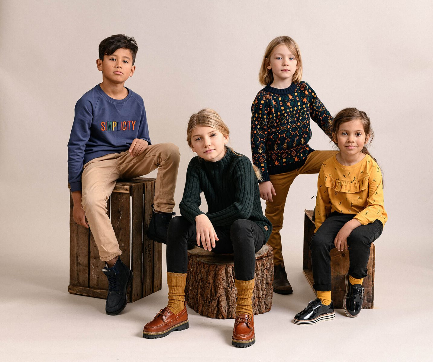 Bunch of kids posing in a studio environment