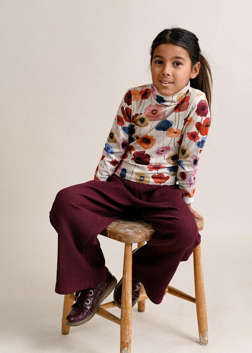 Kids portrait in studio, sitting on a stool