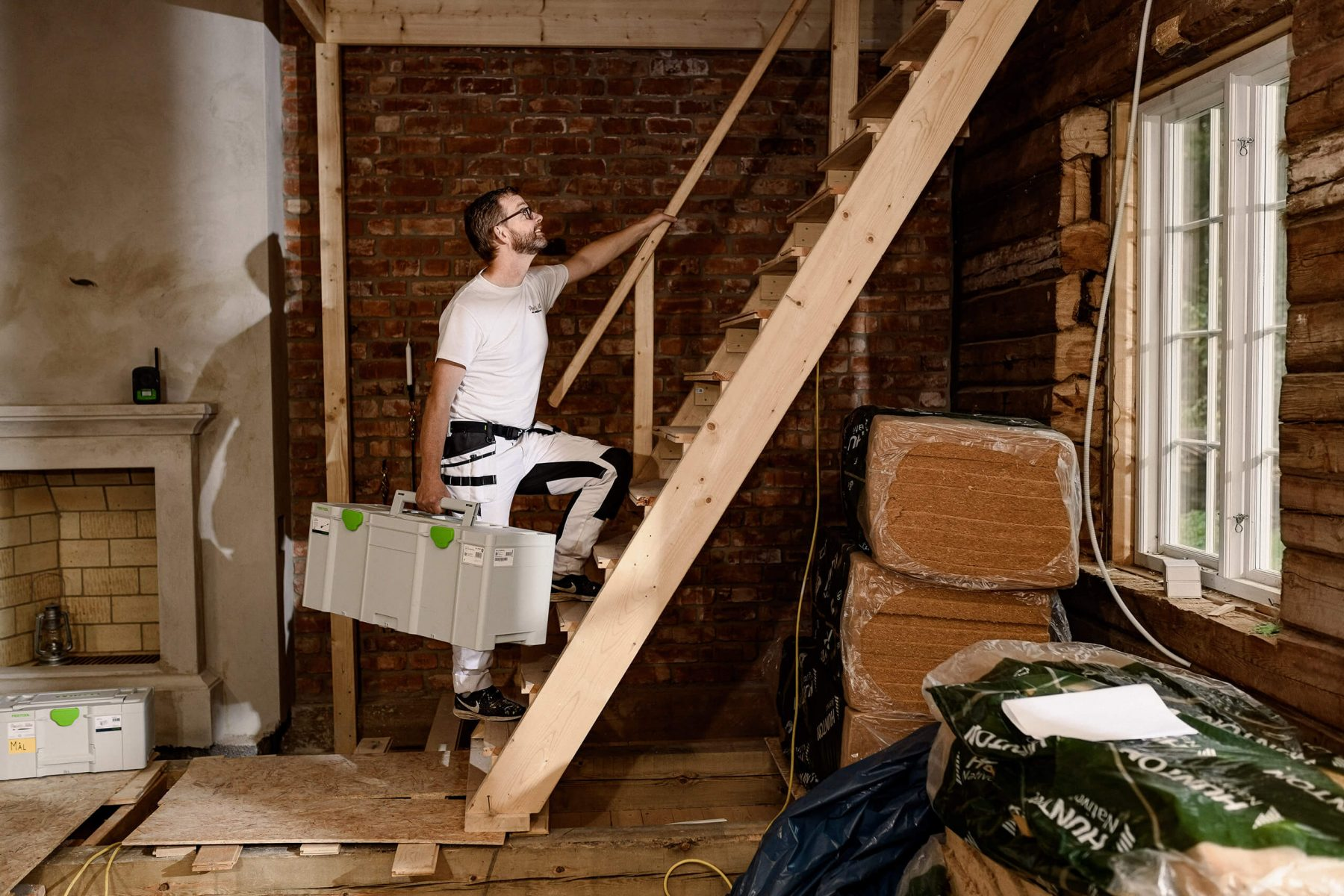 Man walking up the stairs with Festool gear