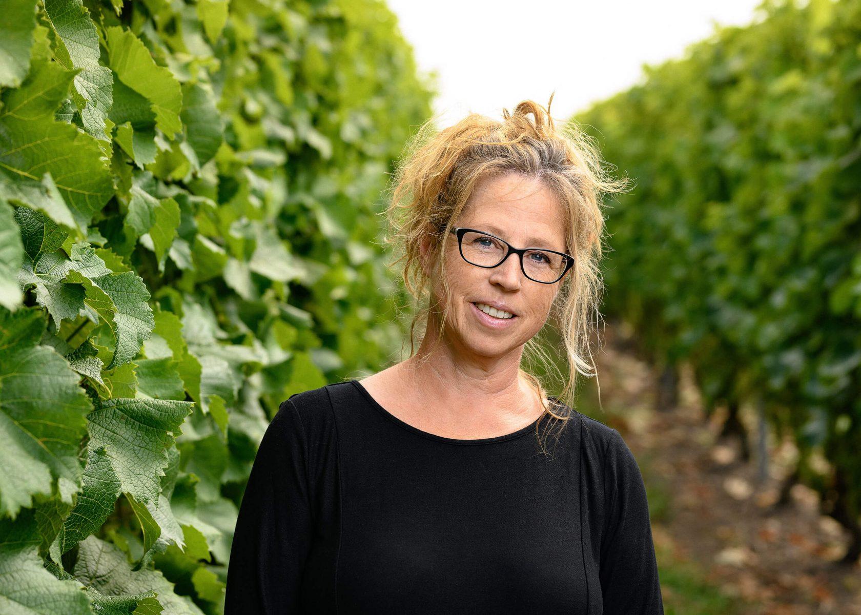 Portrait of owner of Klagshamn vineyard among the grape fields