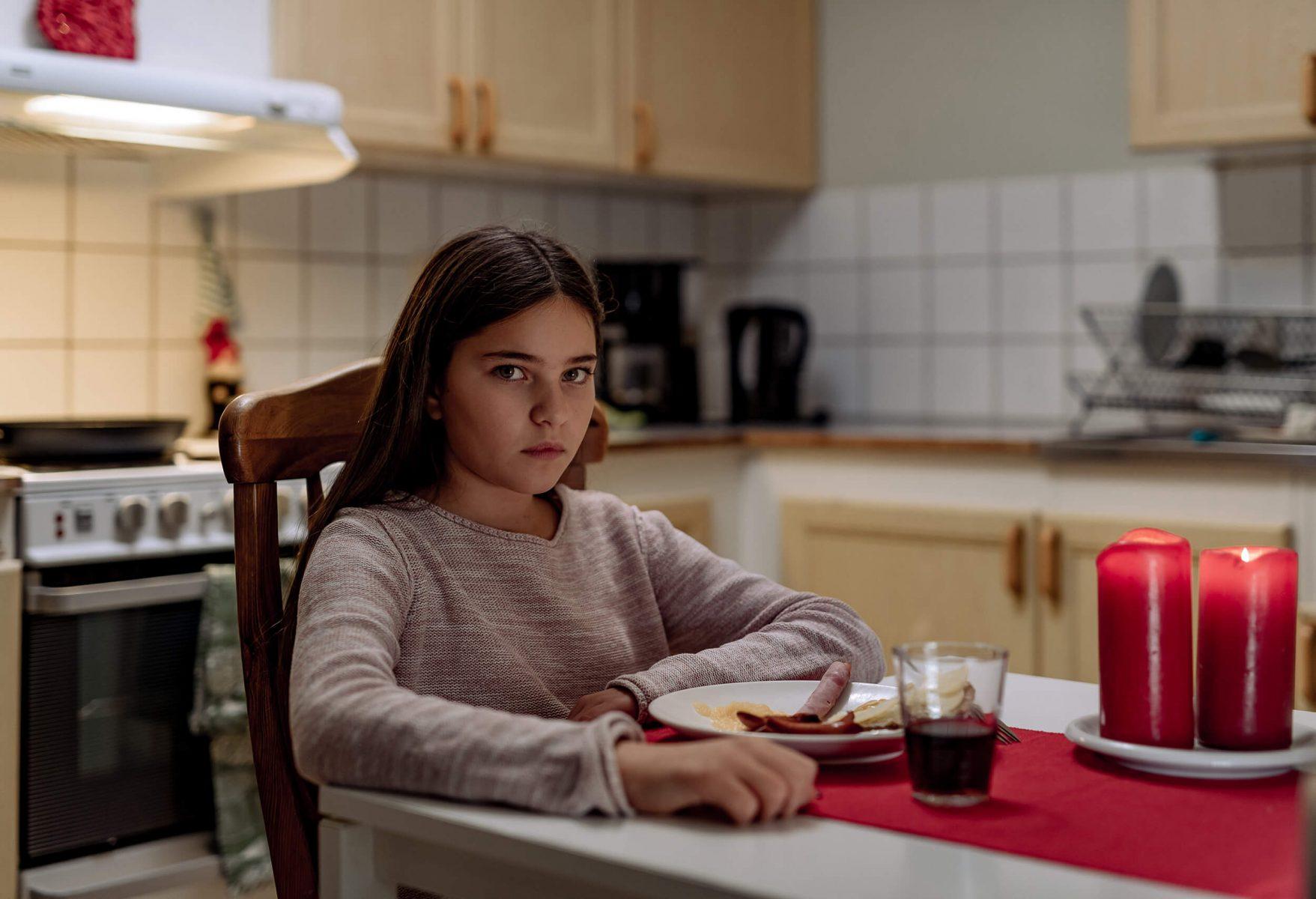 Girl eating Christmas dinner.