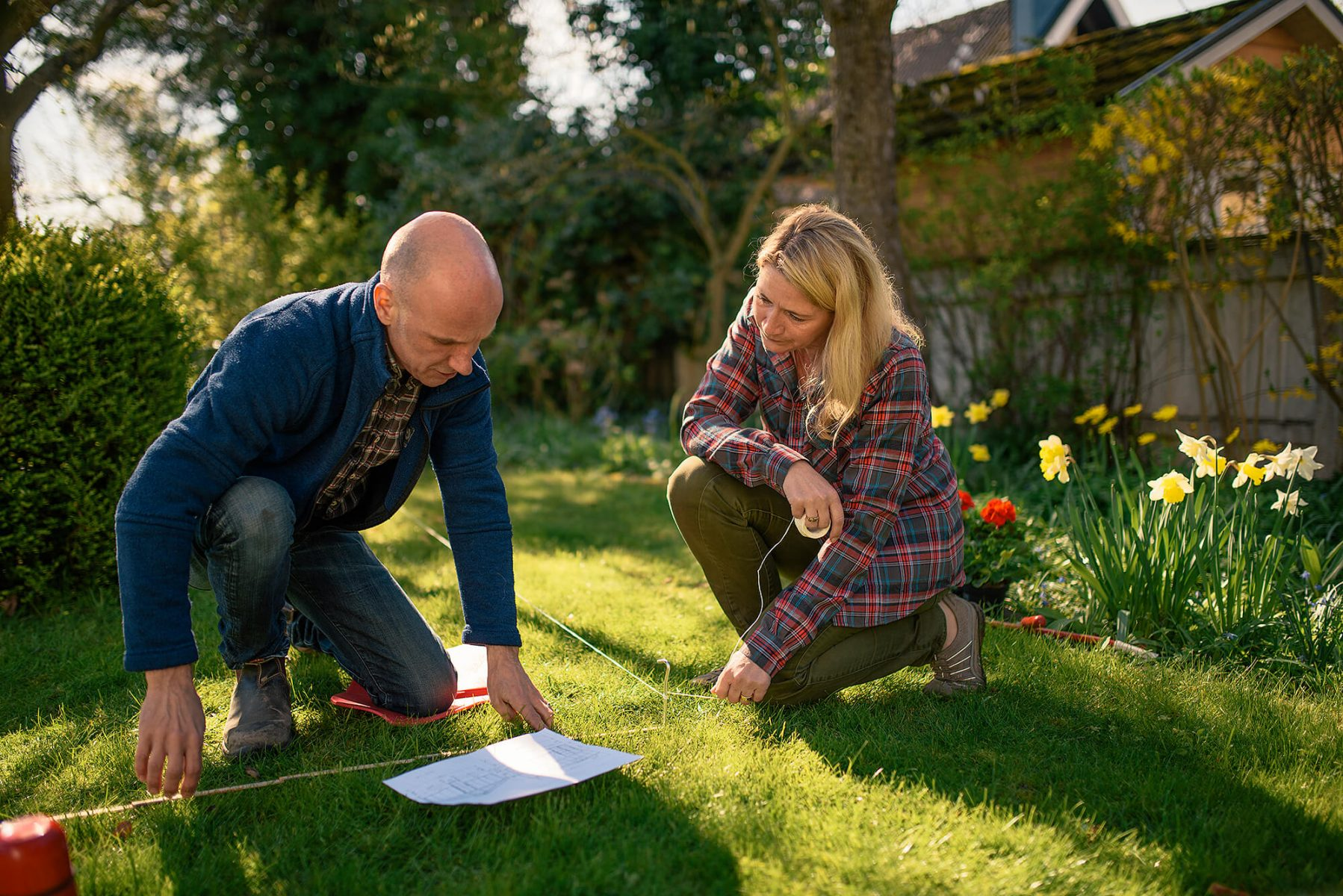 Couple planning a orangery in their garden. Looking happy.