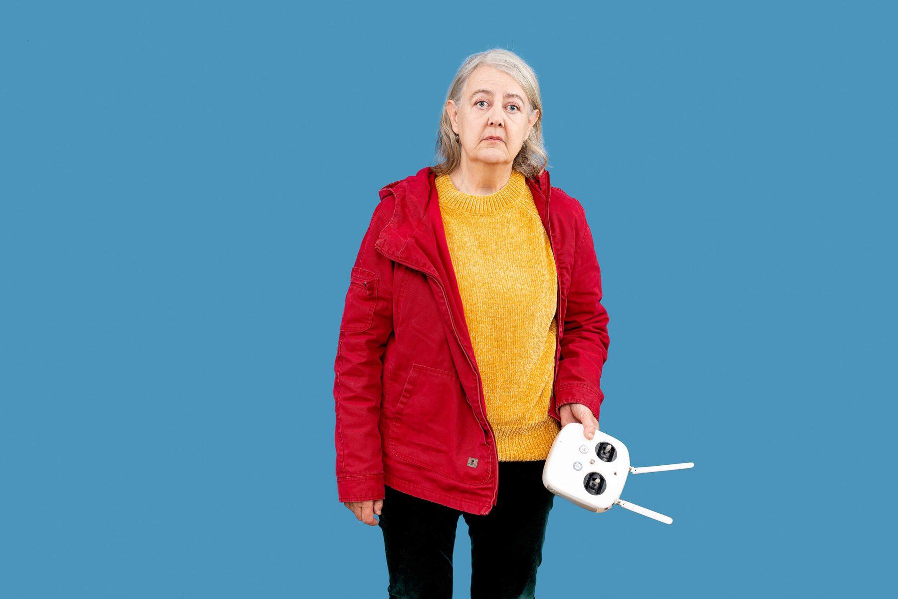 Sad woman in studio. Crashed a drone.