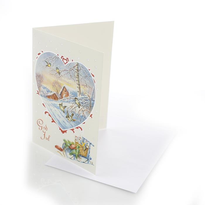 Dubbelt julkort där framsidan visas här. Ett hjärta med fåglar och träd samt en kälke