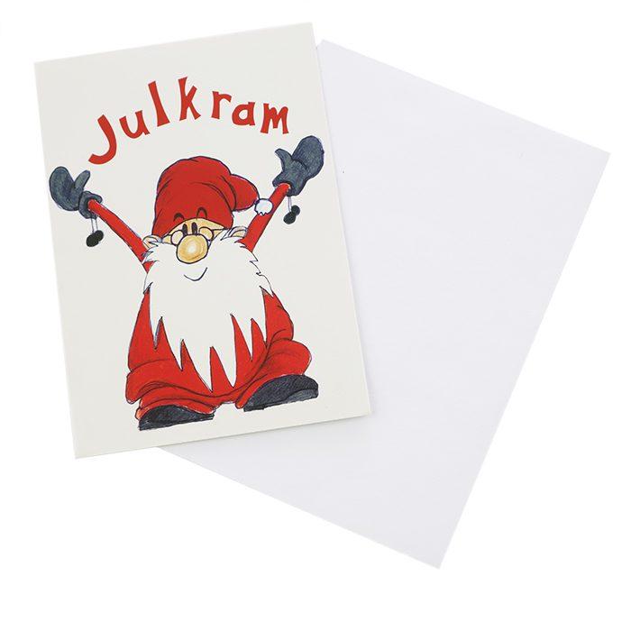 Dubbelt julkort där framsidan visas här. En tomte med uppsträckta armar och texten Julkram