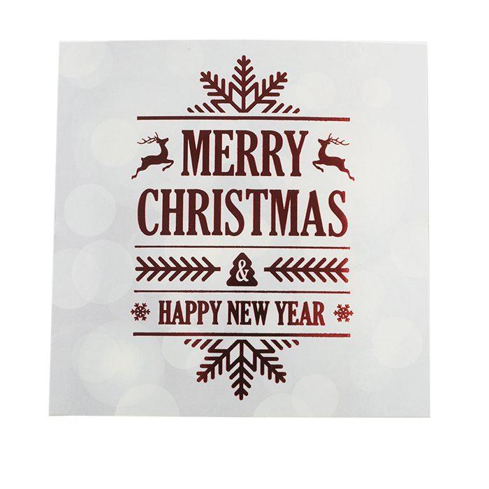 Ett vitt glammigt julkort med text i folierött