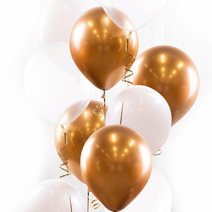 Gallongbukett gold. Ett fång med ballonger i guld, vitt och transparent