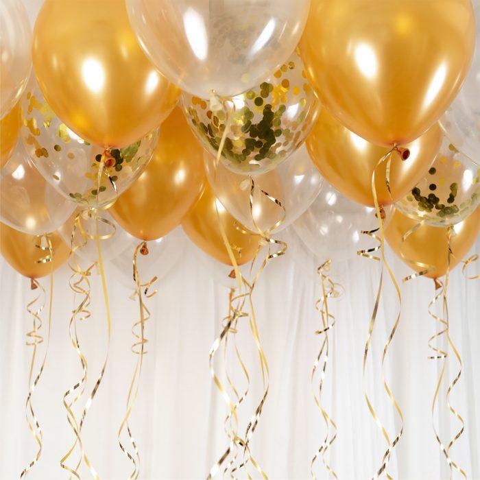 Ballong Ceiling Chamoange Ett kit med guld och transparanta ballonger att fästa i taket eller att blåsa upp med helium