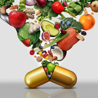 Vitamin dietary supplement as a capsule with fruit vegetables nuts and beans inside a nutrient pill as a natural medicine health treatment with 3D illustration elements.