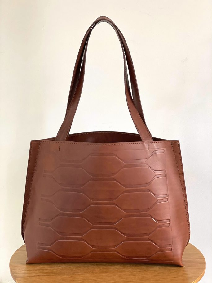 Gallery is a chestnut debossed leather tote