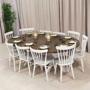 Runt matbord med 1 iläggsskiva, rustikgrå bets, vita ben. 140 cm.