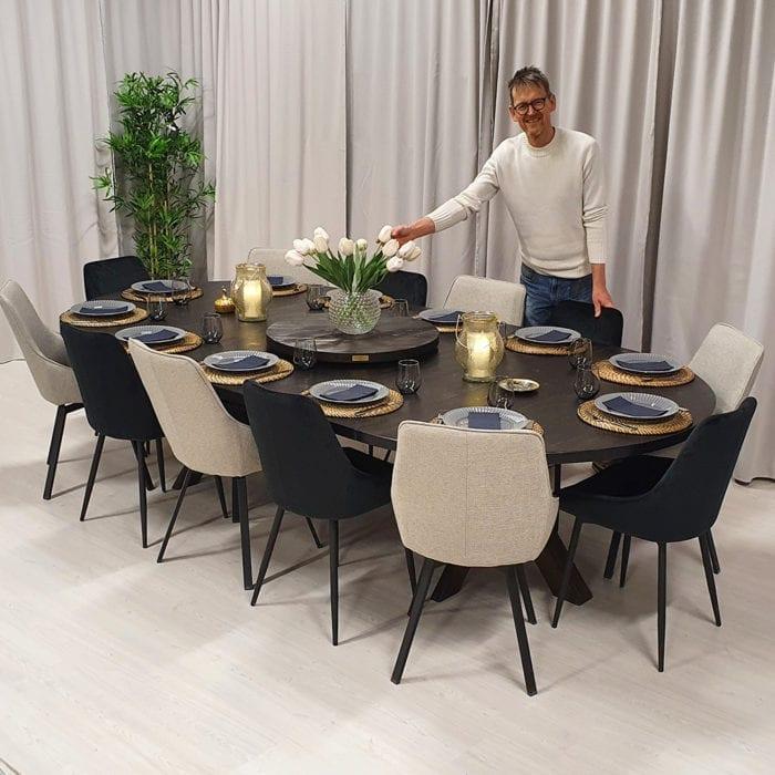 Runt matbord med 2 iläggsskivor, tjära dubbelbets. 150 cm.