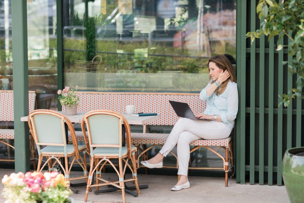 Sanna Koritz on Laptop Outside Cafe