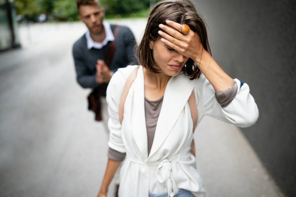 Breakup of couple with man and sad girlfriend outdoor. Divorce, couple, love, pain concept
