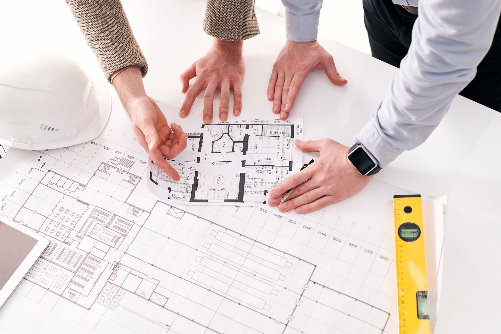 Discussing flat plan with architect