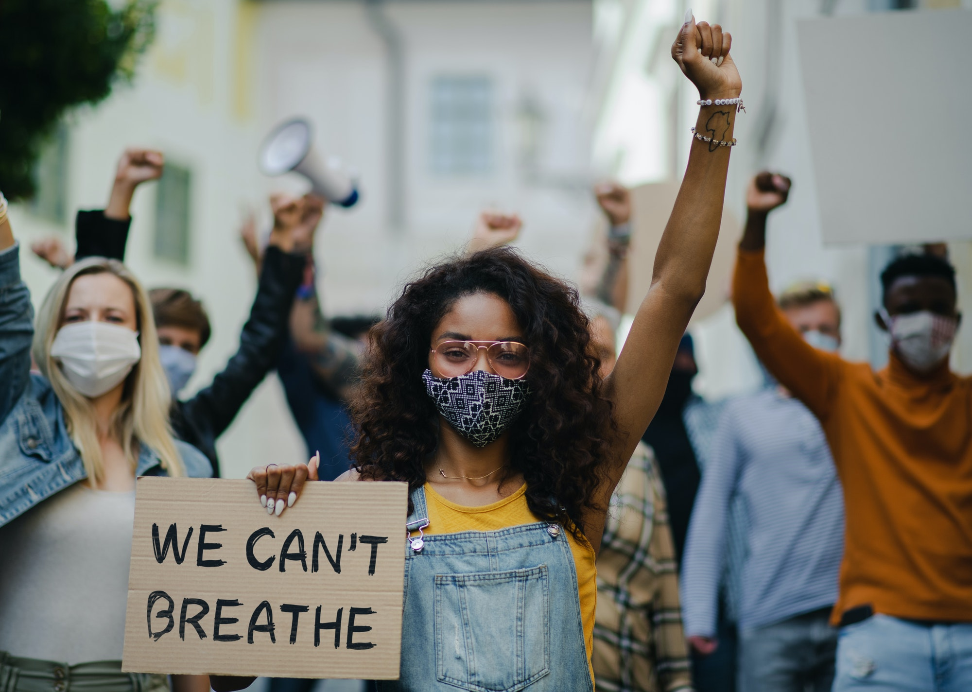 Group of people activists protesting on streets, BLM demonstration and coronavirus concept