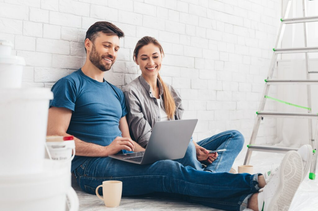 Young couple planning design project for apartment