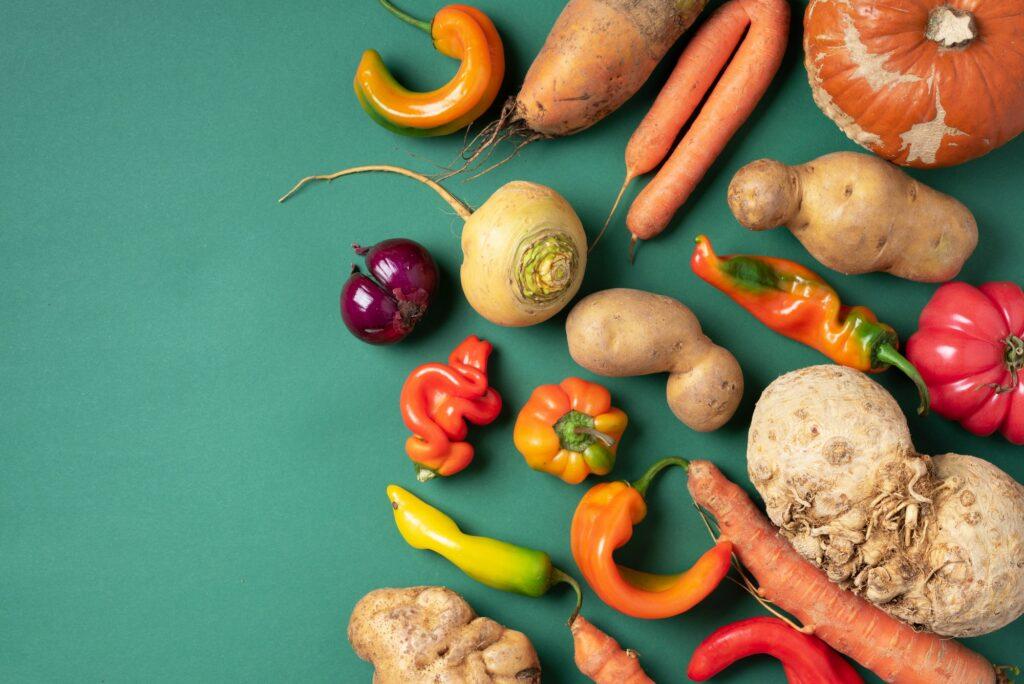 Trendy ugly organic vegetables. Assortment of fresh eggplant, onion, carrot, zucchini, potatoes