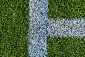 White lines on a green artificial football field