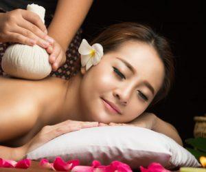 asian-woman-getting-thai-herbal-compress-massage-spa_50889-6