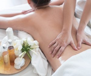 attractive-caucasian-woman-lying-down-massage-bed-spa_35048-1369