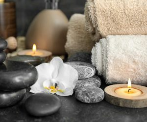 Beautiful spa composition with stones and orchid flower on table