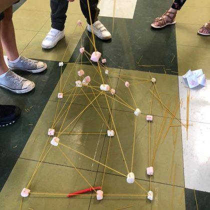 Photo showing marshmallow and pasta construction creativity.