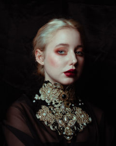 classic portrait of blonde woman with red lips
