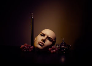 still life photograph by molly baber of head candle grapes