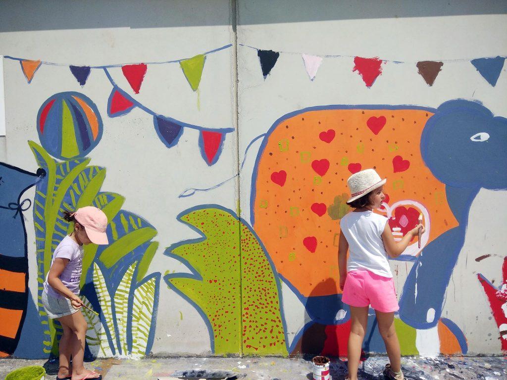 pintando muros campamento