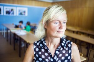 Thoughtful teacher in classroom
