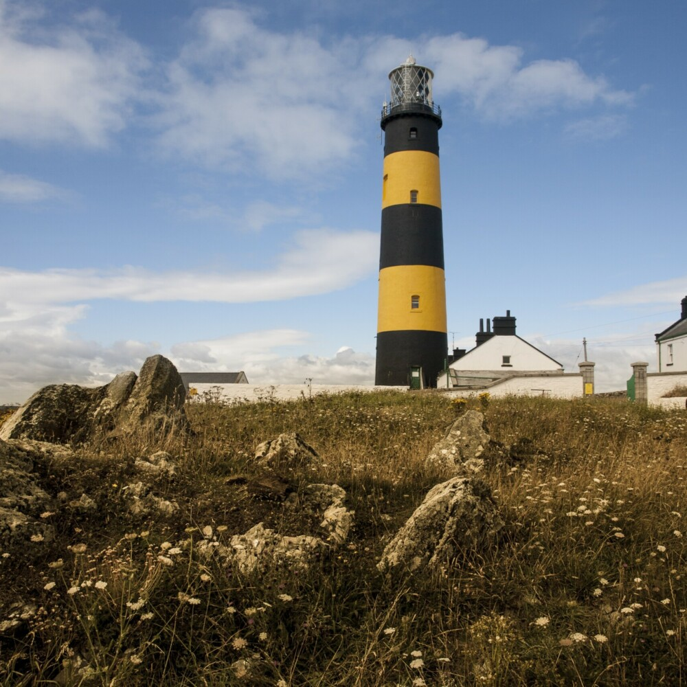 Low angle shot of the St John's Point lighthouse in Killough on Dundrum Bay in Northern Ireland Taxi Tours Antrim