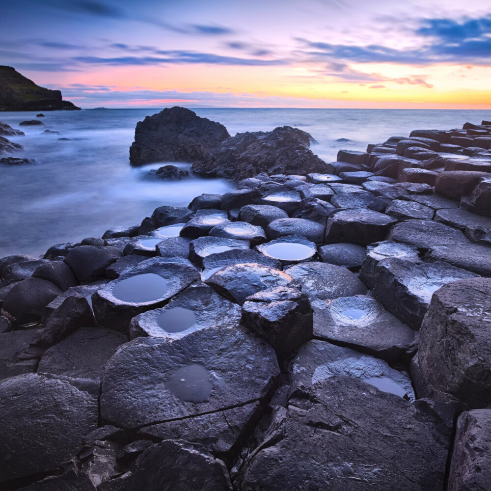 sunset over rocks formation Giants Causeway, County Antrim, Northern Ireland, Taxi Tours Antrim