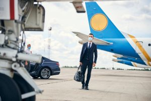 Modern businessman travelling safely with a mask on