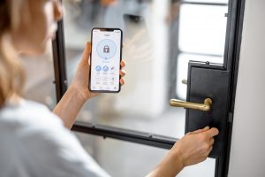 Smartphone with launched application for alarm security
