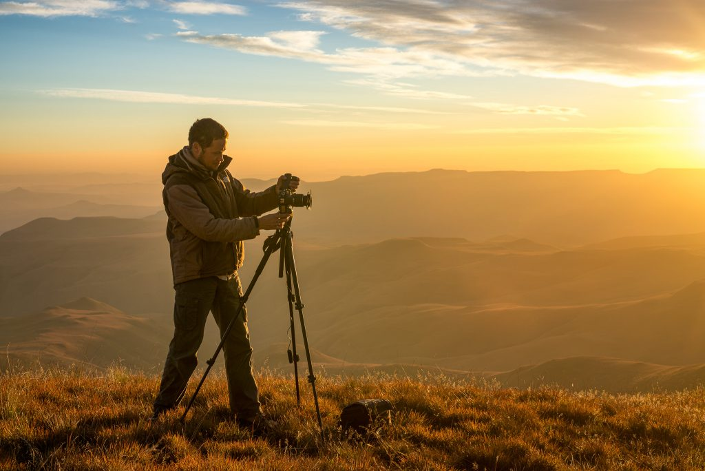 Nick van de Wiel photographing from the Lookout Hut in the Drake