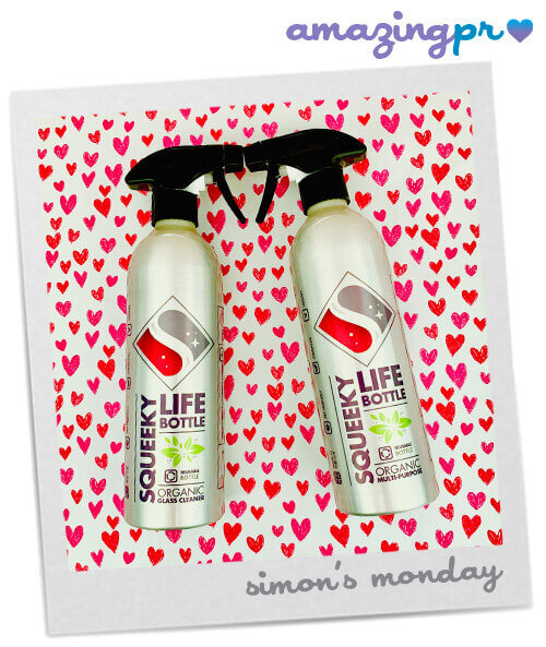 Two squeeky life bottles on hearts background