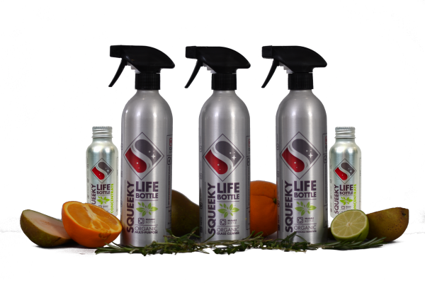 Three Squeeky Life bottles with fruit and concentrate refill bottles