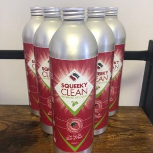 Five bottles of Squeeky natural plastic free washing up liquid on a shelf