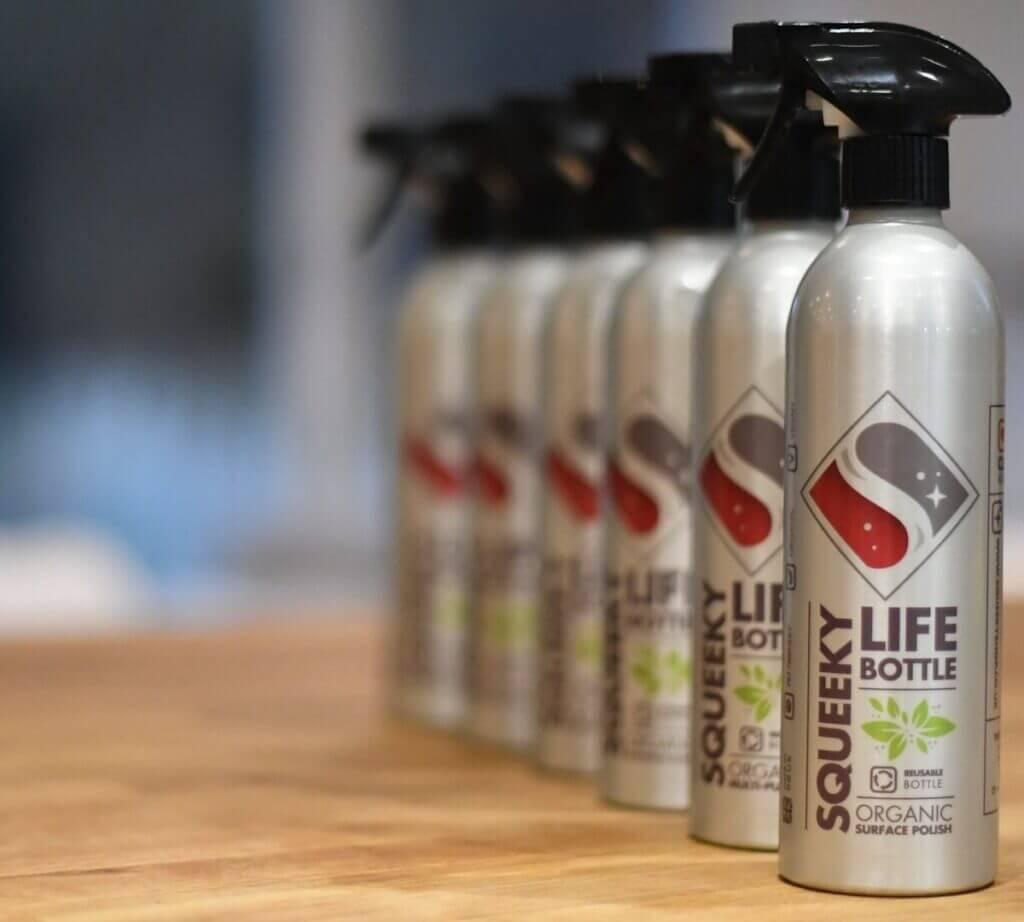 Six Squeeky life bottles on worktop.