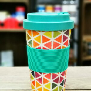 Bamboo Travel Mug with triangle multi colour design on wooden crate