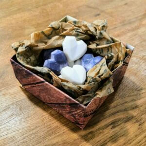 Box of black and white heart shaped soy wax melts in plastic free packaging