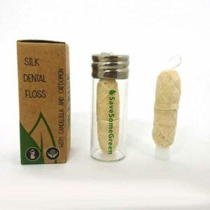 Silk dental floss in box, in glass dispenser and outside of dispenser