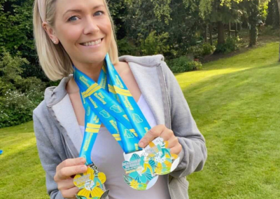 Suzi Shaw with Seasoned Runner medals
