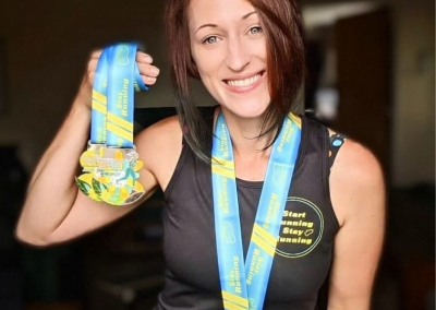 The Happy Runner with Spring Medals